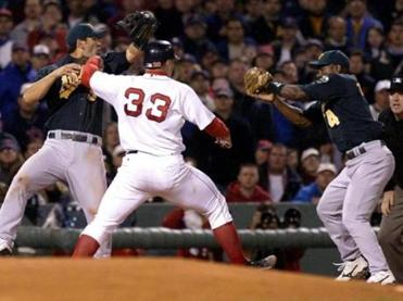 Jason Varitek was safe at third after interference was called on Eric Chavez, left, on this play.