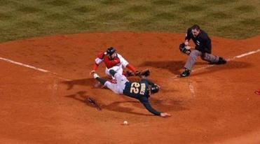 Oakland's Eric Byrnes missed home on this play, and Varitek picked up the loose ball and tagged him out.