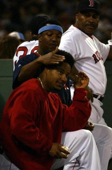 A playful Pedro Martinez altered Manny Ramirez's hair during the sixth inning while the Sox were up 20-5.