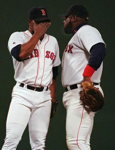 Mo Vaughn, right, came to the mound to visit with pitcher Tom Gordon in the eighth inning.