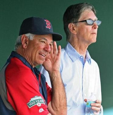 Sox owner John Henry (right) has pledged not to dismiss Bobby Valentine before season's end, but there is little to be gained by keeping him.