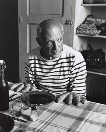 Robert Doisneau's photograph of Pablo Picasso, with the artist posed as if he has bread for hands.