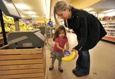 Heather Barr and daughter Zoe, 3, scan at Stop & Shop in Quincy.