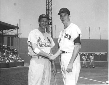 Don Schwall and Stan Musial on the third-base side of the field.