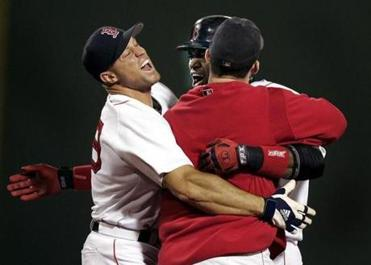 Gabe Kapler (left) and Trot Nixon (right) hugged Ortiz after his game-winning hit in the bottom of the 14th inning.