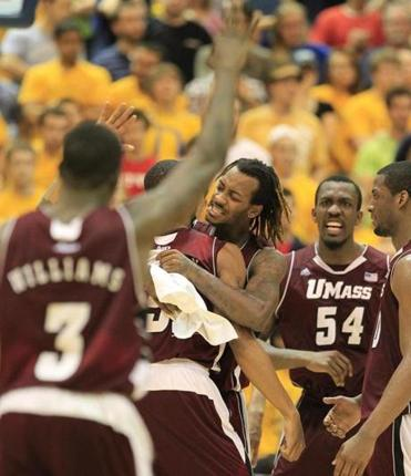 UMass' Jesse Morgan is swarmed by teammates after hitting a three-pointer late in the second half against Drexel.