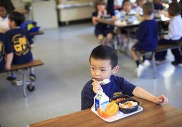 Trac Dzuong ate tacos, vegetables, and an orange in school. A food vendor says the city did an unfair deal with a rival bidder.