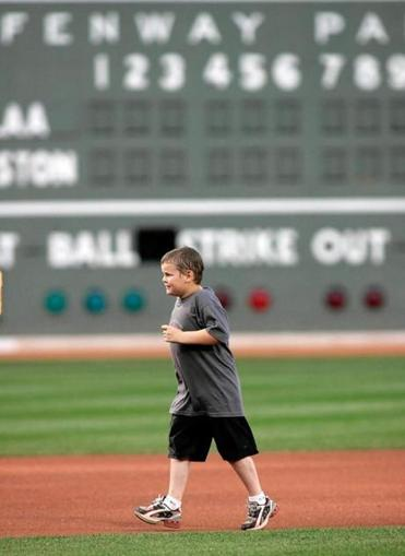 Jimmy Fund patient Jordan Leandre, 7, ran the bases after singing the national anthem.