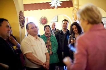 Senate candidate Elizabeth Warren took her message to patrons of Cafe Azteca in Lawrence. Statewide, many voters are undecided about the race, according to a new Globe poll.