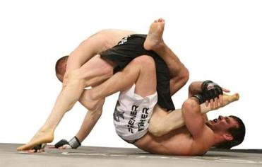 Mixed martial arts fighters Ryan McGivern (left) and Dan Miller battled during a 2008 bout in Uncasville, Conn.