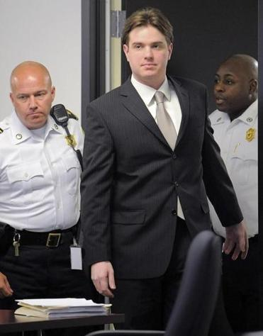 Court officers escorted Neil Entwistle (center) into the courtroom during his murder trial In this June 19, 2008, file photo.