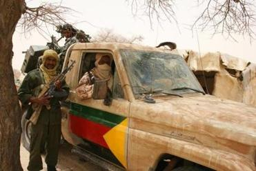 Tuareg separatist rebels near their vehicle in Timbuktu last week.