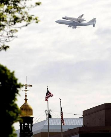 The space shuttle Discovery, atop a 747 carrier aircraft, flew over Washington today on the way to its new home at the Smithsonian's National Air and Space Museum's Steven F. Udvar-Hazy Center in Chantilly, Va.