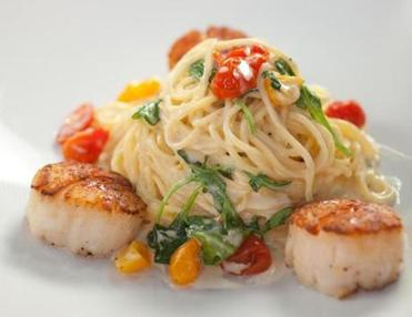 The lemon angel hair pasta served with pan seared diver scallops.