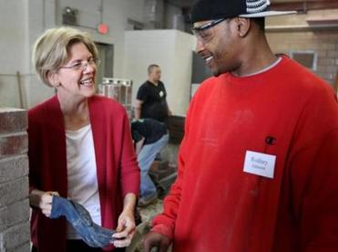 Elizabeth Warren met Rodney Johnson Thursday at a job training center in Dorchester.