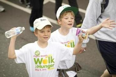 Ben (left) and Alex Haswell, 9, were among the thousands participating in the 44th annual Walk for Hunger Sunday. The event raises money for more than 450 emergency food programs.