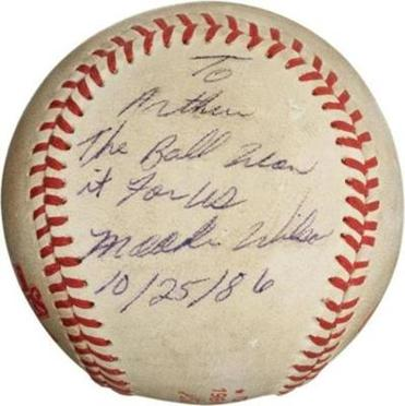 "This undated image provided by Heritage Auctions, shows the ""Buckner Ball,"" the baseball that dribbled between the legs of Boston Red Sox first baseman Bill Buckner during the 10th inning of Game 6 of the 1986 World Series."