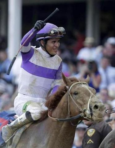 A jubilant Mario Gutierrez and a muddied I'll Have Another are headed for the Churchill Downs winner's circle.