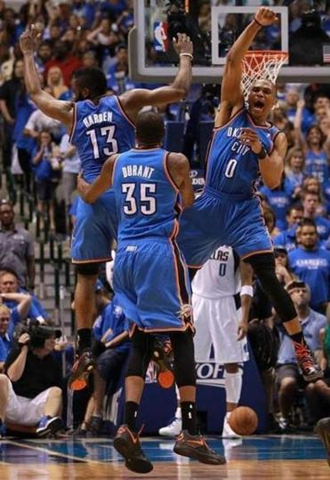 James Harden (13), Kevin Durant (35), and Russell Westbrook begin the Thunder's celebration.