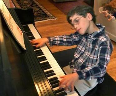 SUDBURY;10/1/01- Nine year old Matthew Savage, a musical genius, whirls throgh one of his original jazz compositions on the piano. He is autistic. GLOBE STAFF PHOTO BY TOM HERDE -- Library Tag 10132001 Living
