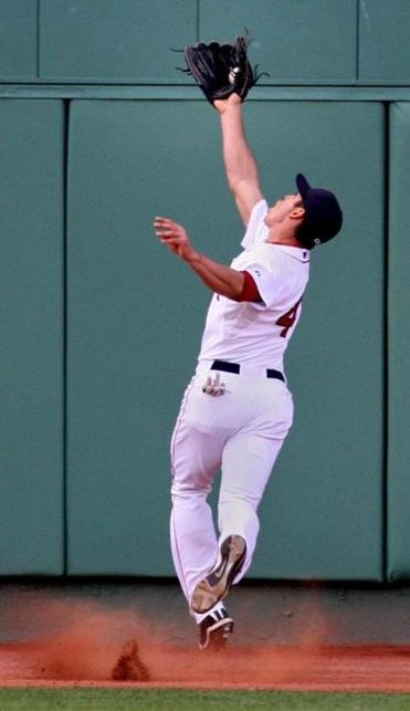 Jacoby Ellsbury made one of his 12 catches against the Blue Jays.