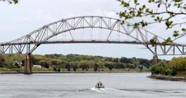 Construction work continued on the Sagamore Bridge on Tuesday, but the hope is to have work done and traffic flowing by the busy Memorial Day weekend.