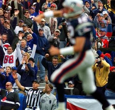 Tom Brady led the cheering as the Patriots scored one of their three rushing touchdowns.