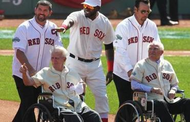 Jason Varitek and David Ortiz escorted Johnny Pesky to the mound as Tim Wakefield did the same for Bobby Doerr as they celebrated the 100th anniversary of Fenway Park.