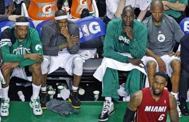 6-7-12: Boston, MA: The Celtics starting five of (left to right) Brandon Bass, Paul Pierce, Rajon Rondo, Kevin Garnett and Ray Allen are a glum bunch on the bench in the fourth quarter, having already been puled from the game, as they watch Miami's LeBron James (6) still in action on the court, as the Heat superstar torched Boston on the way to a 98-79 series tying victory. The Boston Celtics hosted the Miami Heat for Game Six of the NBA Eastern Conference Finals at TD Garden. (Globe Staff Photo/Jim Davis) section: sports topic: Heat-Celtics
