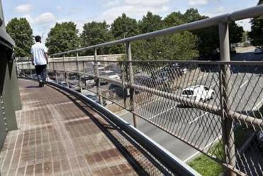 For Business - Boston, MA -- 06/18/12 -- The elevated walkway over Storrow Drive that leads to the Massachusetts Eye and Ear Infirmary parking lot. Patients have to walk up and down stairs and across this elevated walkway in order to access the building from this part of the parking lot. (Kayana Szymczak for the Boston Globe)
