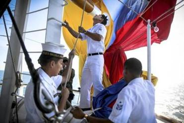 Crew members aboard the ARC Gloria of Colombia raised the flag of Colombia.