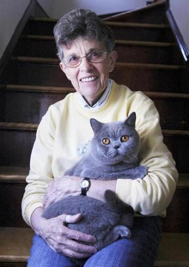 Marilyn Conde at home in Peabody with her prize-winning British sorthair cat, nicknamed Levi for short.