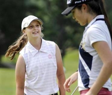 Thibodeau with Julia Yao; they both compete in the 14- to- 18-year-old division of the NewEngland PGA.