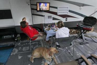 Kenny and Donna Barrus of Plymouth watched television during dinner at Bayview Campground in Bourne. Owners of campgrounds say offering Wi-Fi service is almost a must — and some guests prefer a strong signal to a good view.