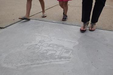 "Sidewalk stamps for ""Little Engine that Could"" walk."