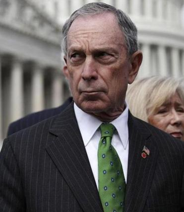 Mayor Michael Bloomberg applied pressure on the presidential candidates two days after a gunman killed 12 people at a movie theater in Aurora, Colo., using an assault rifle and other semiautomatic weapons.