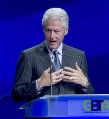 Former President Bill Clinton addressed the audience at the annual 2012 Global Business Travel Association Convention at the Boston Convention and Exhibition Center on Wednesday.