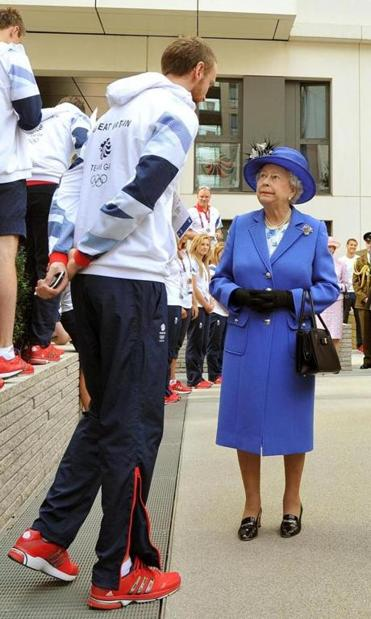 A day after her starring role in the Opening Ceremonies, Queen Elizabeth II mingled with Great Britain's athletes.