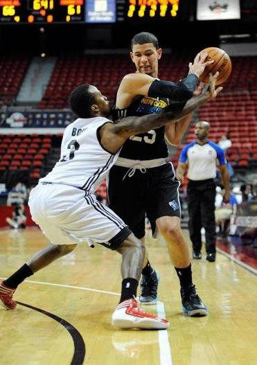 Portland Trail Blazers' Dee Bost defended New Orleans Hornet Austin Rivers during an NBA Summer League game on July 15 in Las Vegas.