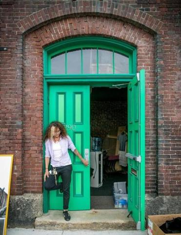 Artistic director Diana Coluntino in the doorway of the Revolving Museum, the art space in Lowell that closed last month.