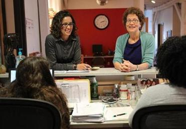 Marissa Guananja (left) and Ann Houston set up a coaching system modeled after the Weight Watchers program to help clients become financially self-sufficient.