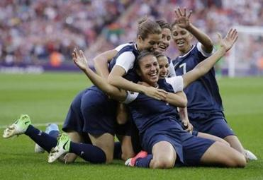United States' Carli Lloyd, right, celebrates with teammates after scoring during the women's soccer gold medal match against Japan. (AP Photo/Ben Curtis)