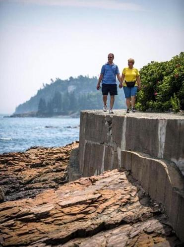 Bob and Carol Long of Pennsylvania walk along the Shore Path in Bar Harbor, Maine. NewEngland offers a wealth of food, fun, and adventure for baby boomers.