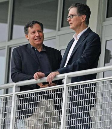 Despite the Red Sox' dreadful season, and the public backlash, chairman Tom Werner (left) insists he and John Henry (right) have no plans to sell.