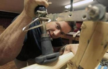 Jesse LaCasse makes wooden baseball bats at his facility in Skowhegan, Maine, that has been in his family for generations.