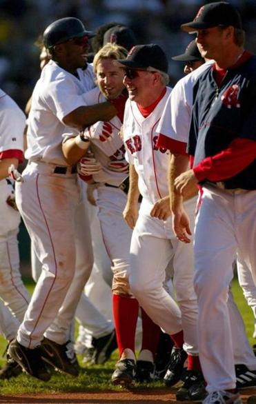 Teammates mobbed Kevin Millar after his game-winning hit.