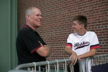"""I think they're building, I don't think they're crumbling,"" said Red Sox fan Bill Marchand, at left with his son Billy."