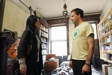 "Jonny Lee Miller and Lucy Liu in ""Elementary."""