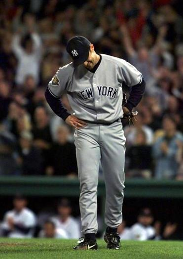 Mike Mussina hung his head after Carl Everett's hit with two outs in the ninth ruined his bid for a perfect game.