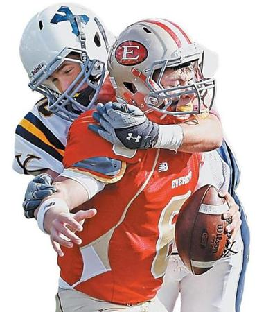 Everett quarterback Jonathan DiBiaso was sacked by Xaverian's Ryan MacLean during a game on Oct. 15, 2011.